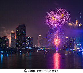 Fireworks countdown (Happy New Year) in city landscape,...