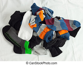 Pile of unsorted socks on white background