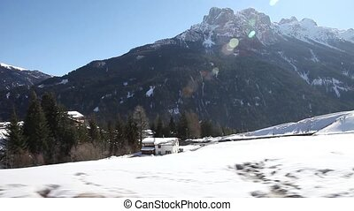 Winter landscape - Typical Italian settlement with Dolomites...