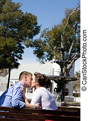 Couple Kissing By Water Fountain