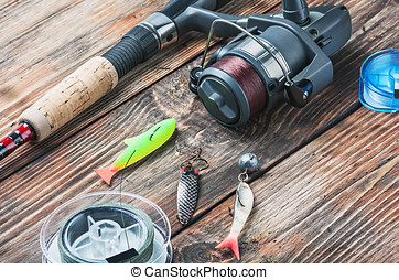 fishing tackle   - fishing tackle on a wooden table