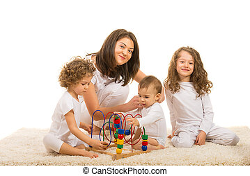 Smiling mother with three kids
