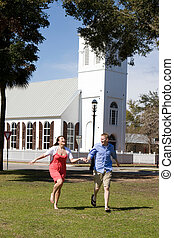 Couple Running By Church