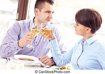Couple drinking wine in a restaurant