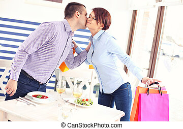 Couple meeting in a restaurant - A picture of a young couple...