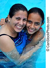 Mother and daughter in pool