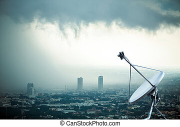 satellite dish with storm background