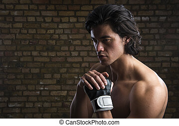 Malaysian boxer - Bare chested young Malaysian boxer wearing...