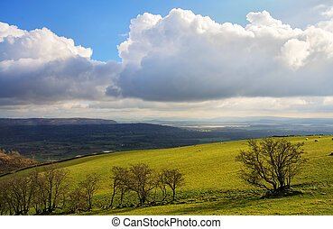 Lyth Valley in Cumbria - Growing cumulus clouds over the...
