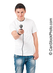 Young man reporter holding a microphone, isolated on white...