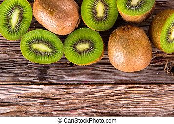 Fresh fruits - Fresh kiwi fruits on wooden table. Wood...
