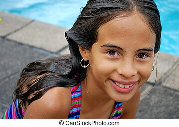 Little girl by the pool - Beautiful Hispanic girl by the...