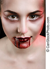 Closeup of Red lips of a young girl, with blood flowing by.