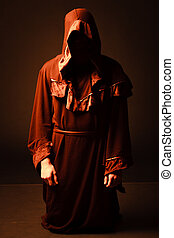 mysterious Catholic monk studio shot