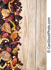 Background with dried fruits on wooden table