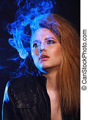 Woman with Cigarette Exhaling Smoke  on a Dark Background