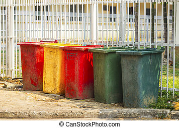 colourful dustbins in the public area of a port