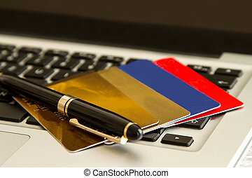Credit cards over a keyboard - Use of credit card for...