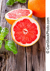 Fresh fruits - Fresh grapefruit with slices on a wooden...