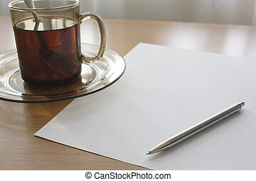 Writing for a cup of tea - Glass mug with it is expected,...