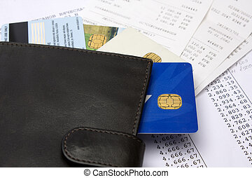 Home Finances - Wallet with credit cards on bills and checks