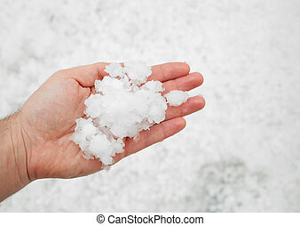 Hailstorm in the hand - Small grains of hail in the hand.