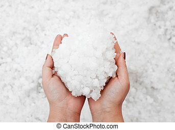 Hailstorm in the hands - Small grains of hail in the hands.