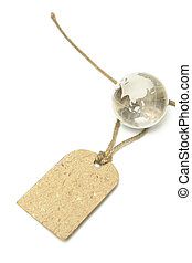 Blank tag and glass Earth on white. World price, Earth sale,...