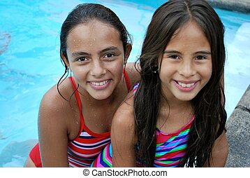 Little girls by the pool