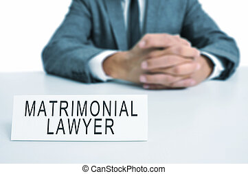 matrimonial lawyer - a man wearing a suit sitting in a desk...