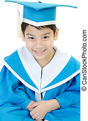 Asian cute Child in Kindergarten graduation uniform .