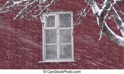 winter  snow falling on farm house
