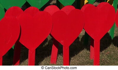 beautiful wooden colorful hearts in city park Lithuania flag...