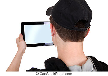 Teenager with Tablet Computer - Young Man holding Tablet...