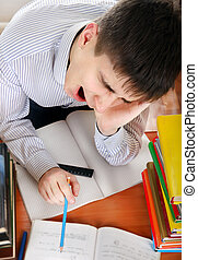 Student Tired - Tired Student is Yawning at the School Desk