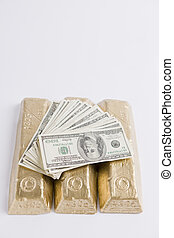 Gold hard Cash - One Hundred Dollar Bills on top of gold...