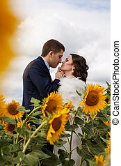 Happy bride and groom. - Beautiful newlyweds kissing in a...