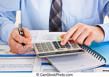 Business accounting - hands in combination with facilities...