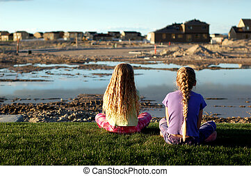 There Goes the Neighborhood - Two young children watch as...