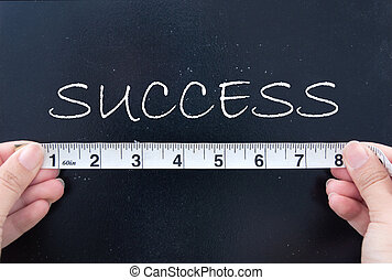 Measuring success - Tape measuring the word success on a...