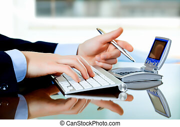 Business accounting - Female hands in combination with...