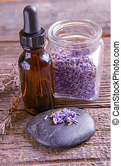Lavender essential oil with lavendula flowers on the rock...