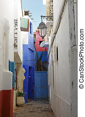 Colorful backyard in Assila, Morocco - Colorful and narrow...