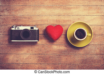 Camera, red heart and cup of a coffee
