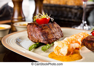 Surf and turf - Beef steak and shrimp with grilled...
