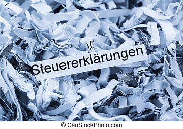 shredded paper tax returns - shredded paper tagged with tax...