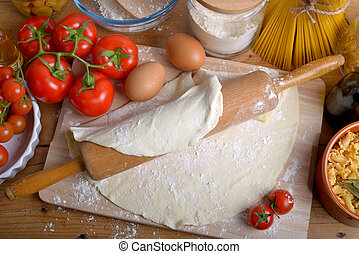 ingredients for homemade italian pizza with tomatoes