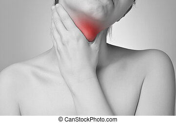 Throat pain - Young woman holding her painful throat