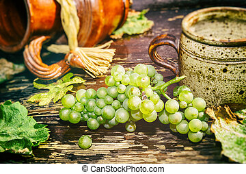 Old ceramic jug, mug and fresh grape