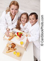 Woman and kids having a light and healthy snack